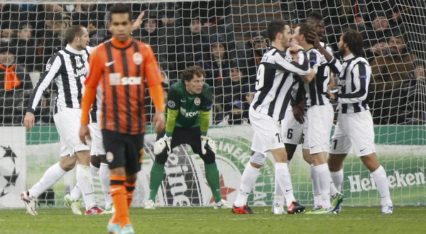Shakhtar Donetsk's goalkeeper Pyatov looks on after conceding an own goal as Juventus players celebrate during their Champions League Group E soccer match at the Donbass Arena in Donetsk