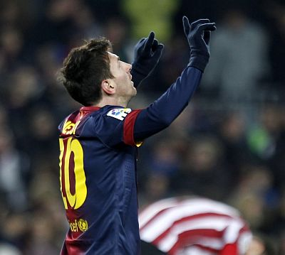 Barcelona's Lionel Messi celebrates his second goal against Athletic Bilbao during their Spanish first division soccer match at Nou Camp stadium in Barcelona